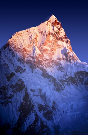 Sunset on Himalayan mountain Lhotse, next to Mount Everest, in Nepal. photo