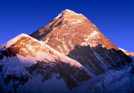 Mount Everest with clear blue sky in the Nepal Himalaya mountain range photo