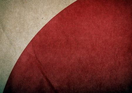Abstract of grunge red circle on brown paper crumpled and creased as background texture photo