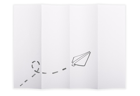 White paper sheet folded in 4 quarters isolated over a white background with a paper aeroplane sketched on it photo