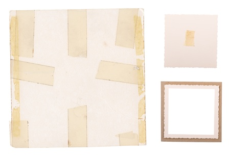 Collection of old photo frames, edges and backings with sticky tape isolated on white photo