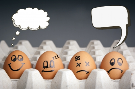 Mental health concept in playful style with egg characters displaying different emotions and blank speech bubbles photo