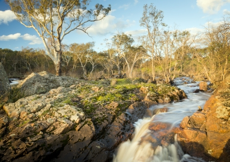 australian landscape: River flows through countryside on its way to Nigretta Falls in Western Victoria, Australia Stock Photo