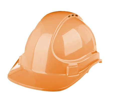 Hard hat used on construction site in orange colour isolated on white photo