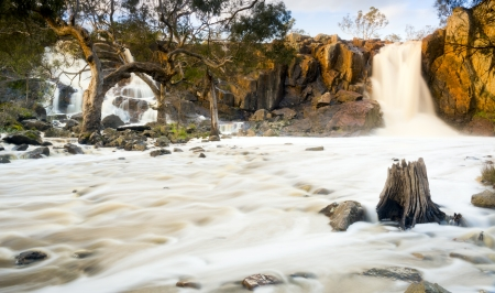timelapse: Beautiful Nigretta Falls waterfall in Western Victoria, Australia with high flow during winter time in time-lapse Stock Photo