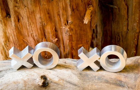 Hugs and kisses symbols xoxo on a rustic wooden background with copy space photo
