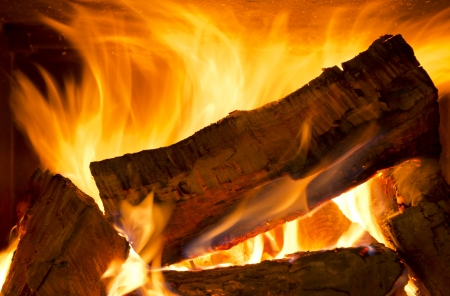 Logs of wood burning bright in a wood fire photo