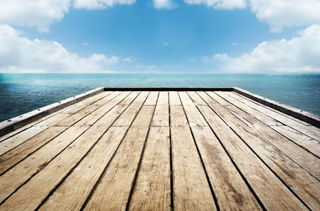 Bright wooden decking surface under a cloudy sky background photo