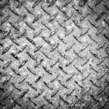 Background texture of checkerplate steel imprint in concrete in stunning black and white Stock Photo
