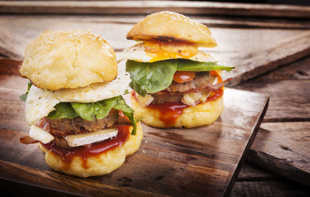 sliders: Home made gluten free mini burgers or sliders with beef, egg, lettuce, cheese and sauce