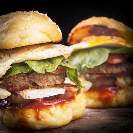gluten free: Home made gluten free mini burgers or sliders with beef, egg, lettuce, cheese and sauce