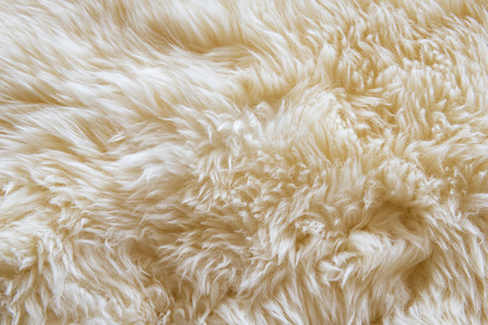 Luxurious wool texture from a white sheepskin rug Stock Photo
