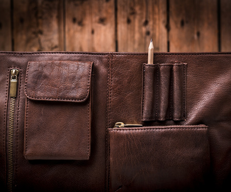 leather briefcase: A mans business briefcase bag, leather satchel with a pencil Stock Photo