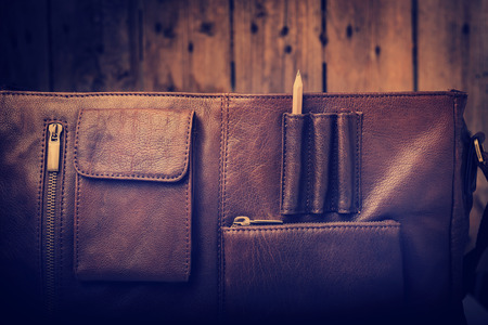 leather briefcase: A mans business briefcase bag, leather satchel with a pencil for creative business