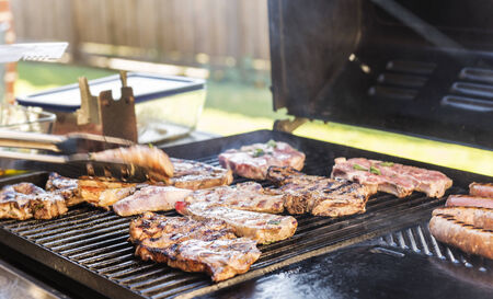 bbq grill: Lamb being grilled on the BBQ at an Australian barbeque outdoor dinner