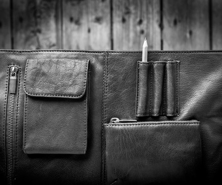 leather briefcase: A mans business briefcase bag, leather satchel with a pencil in black and white