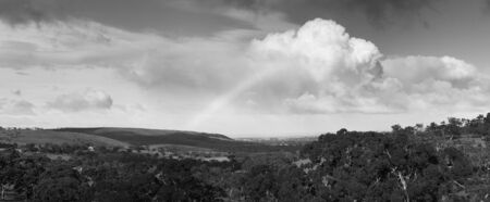 grayscale: Amazing rainbow with huge clouds over Victor Harbour, on South Australia