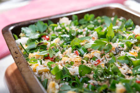 spring onions: Fresh summer style fried rice with spring onions, egg, chicken and garden herbs