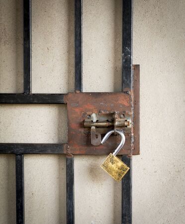 keep gate closed: Large metal gate and open padlock on a burglar prevention door in Botswana, Africa Stock Photo