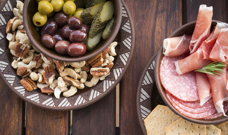 platters: Classic antipasto food platters typical of the Mediterranean including olives, salami, crackers