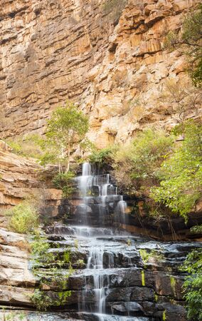 gorge: Waterfall in Moremi Gorge, Botswana, Africa flowing down into the gorge Stock Photo