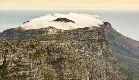 table mountain national park: Cloudy ridgeline of the Twelve Apostles as viewed from the top of Cape Towns Table Mountain, South Africa