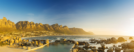 table mountain national park: Sunset panorama of Camps Bay, Cape Town in South Africa Stock Photo