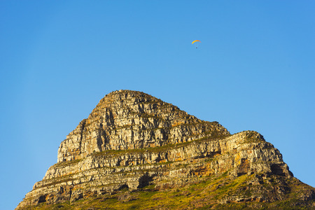 table mountain national park: Paraglider over Lions Head Peak a landmark in Cape Town, South Africa Stock Photo