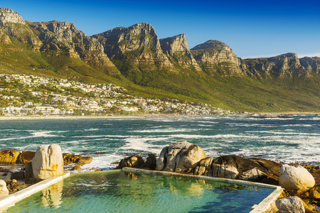 table mountain national park: Camps Bay ocean pool with Twelve Apostles behind