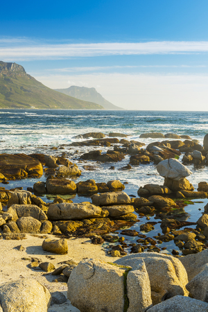 coastlines: Coastal rocks and mountains with  ocean horizon