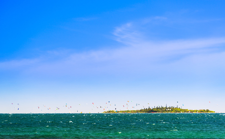 Kitesurfing around the tropical island Ilot Maitre in New Caledonia