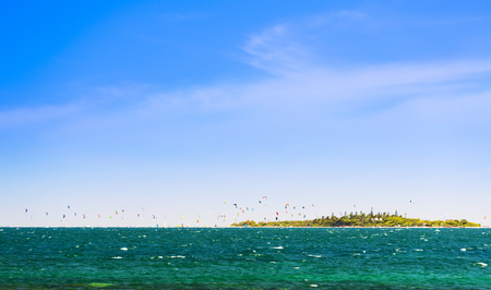 Kiteboarding around the tropical island Ilot Maitre in New Caledonia Stock Photo
