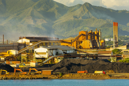NOUMEA, NEW CALEDONIA - APRIL 2016: Nickel mining and smelting operations in the harbor. New Caledonia accounts for roughly 10% of the worlds known nickel supply.