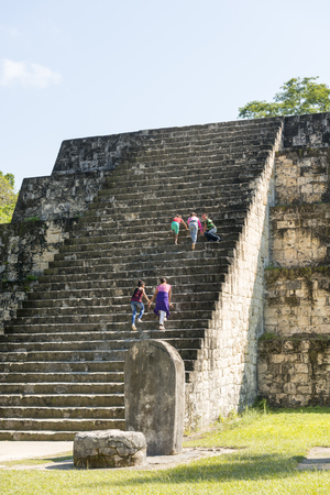 TIKAL, GUATEMALA - NOVEMBER 26: Unidentified people climbed mayan pyramid ruins at an archealogical site in Tikal National Park on November 26, 2017 in Tikal. Stock Photo - 93496168