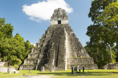 TIKAL, GUATEMALA - NOVEMBER 26: Unidentified people veiw Temple I, also known as the Jaguar Temple, in Tikal National Park on November 26, 2017 in Tikal.