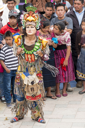 SAN JUAN OSTUNCALCO, GUATEMALA - JUNE 24: Traditional dance done by locals with elaborate costumes and masks at the San Juan Ostuncalco fair in honor of Saint John the Baptist on June 24, 2017 in Guatemala. 에디토리얼