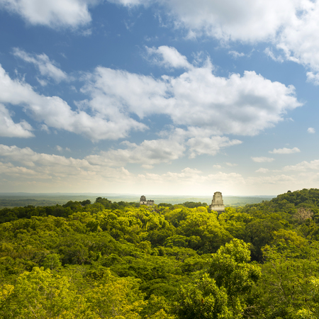 Tikal in Guatemala, an ancient Mayan city in ruins surrounded by jungle Stock Photo