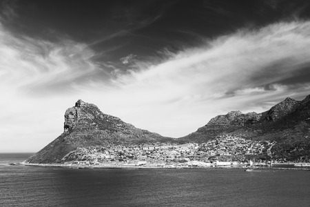 Sentinel peak in Hout Bay near Cape Town, South Africa in black and white Stockfoto