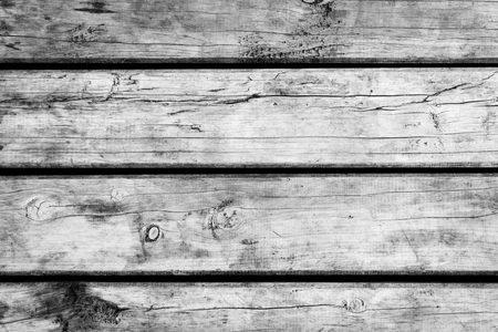 Weathered wooden floorboards background texture in black and white