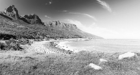 Coastline along the Chapmans Peak Drive near Cape Town in South Africa, Africa in black and white Stockfoto