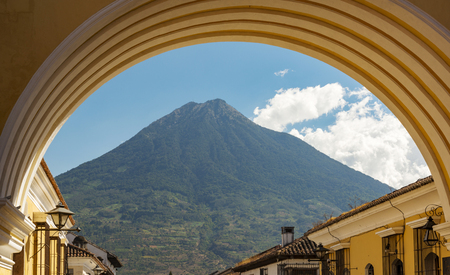 Volcan de Agua looms high behind the city of Antigua, Guatemala in Central America