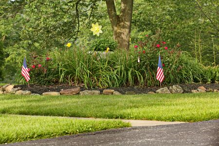 american flags: Garden with American flags Foto de archivo