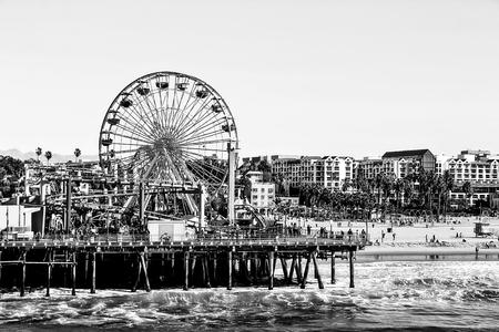 monica: ferris wheel with beach view at Santa Monica, California, USA in black and white Editorial