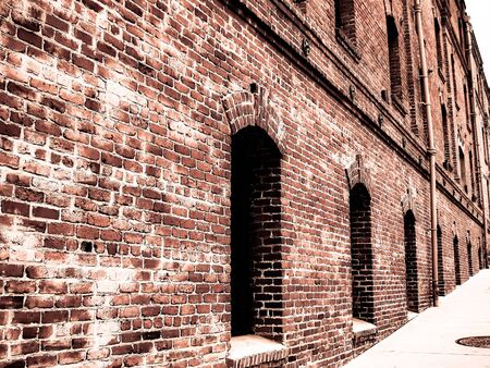 brick building: old vintage brick building with windows and pipes