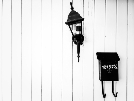 mail box: Outdoor lighting and mail box with wood wall in black and white Stock Photo