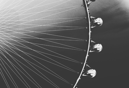 Ferris Wheel with sunset sky background in black and white