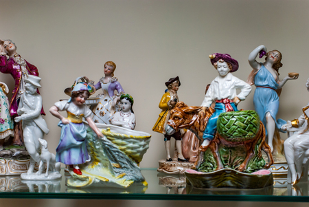 Porcelain rare figures standing in a glass case