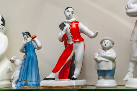Porcelain rare figures standing in a glass case Фото со стока