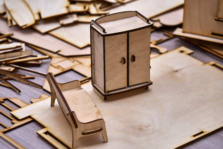 Stock Photo   Toy Small Furniture Laser Cut From Plywood