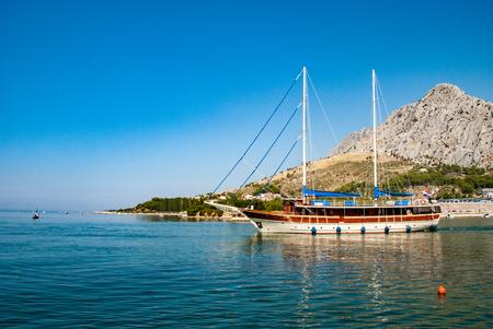 Large sailing ship with deflated sails facing the sea